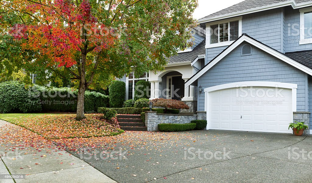 Early autumn with modern residential single family home stock photo