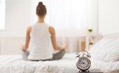 istock Early awakening. Woman practicing yoga in the morning 1179536129