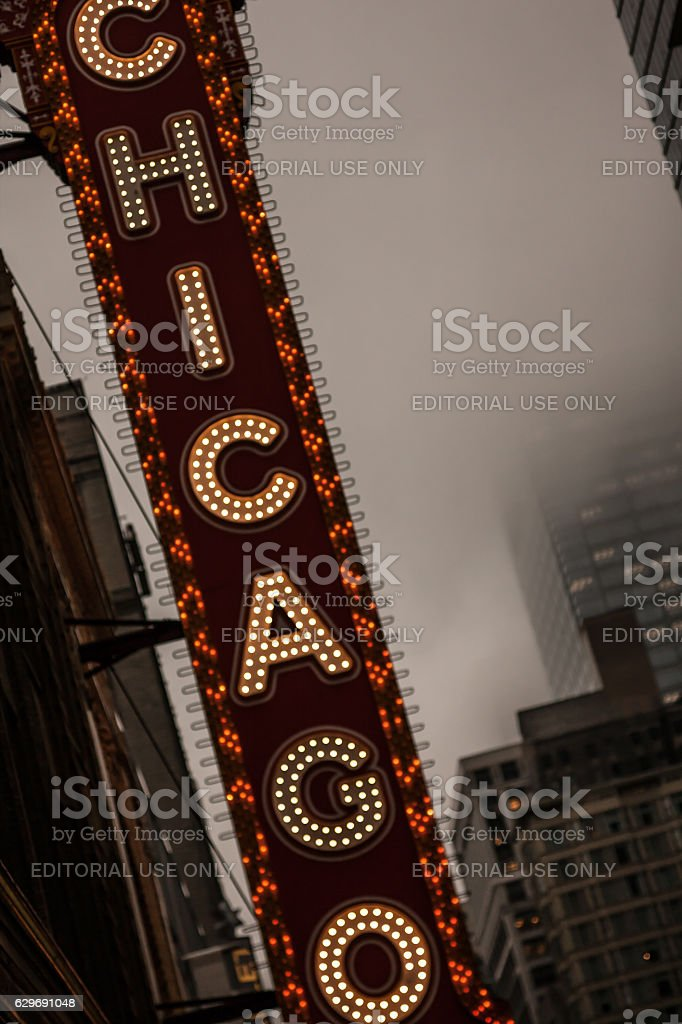 Early evening foggy photo of the Chicago Theatre lighted sign stock photo