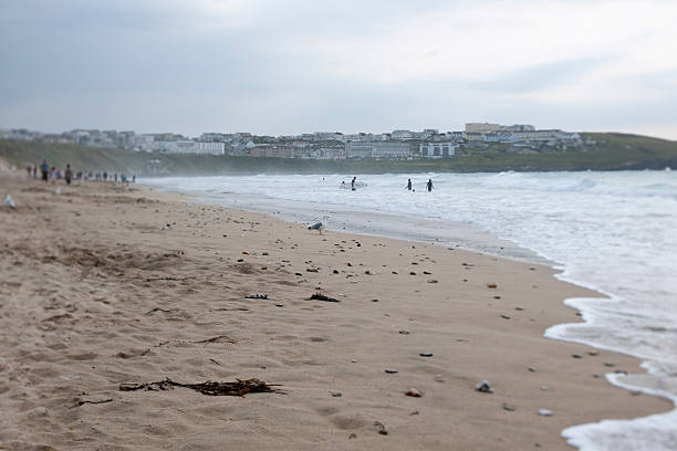 early evening surfers at fistral beach newquay, cornwall - cornwall stock photos and pictures