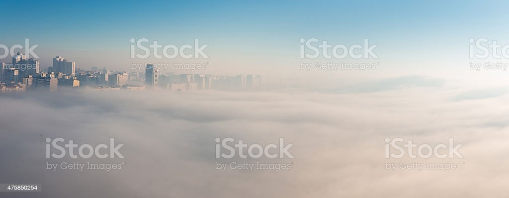 Early foggy morning over the city. stock photo