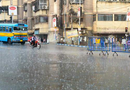Early Monsoon rain falling on city street in a rush hour. Kolkata West Bengal India South Asia Pacific 6th April 2021
