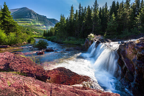 early morning at red rocks falls - us glacier national park stock pictures, royalty-free photos & images