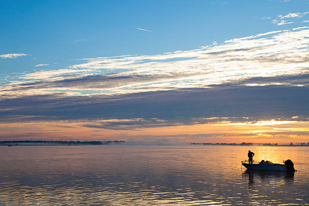 early morning bass fishing on lake toho - kissimmee stock photos and pictures