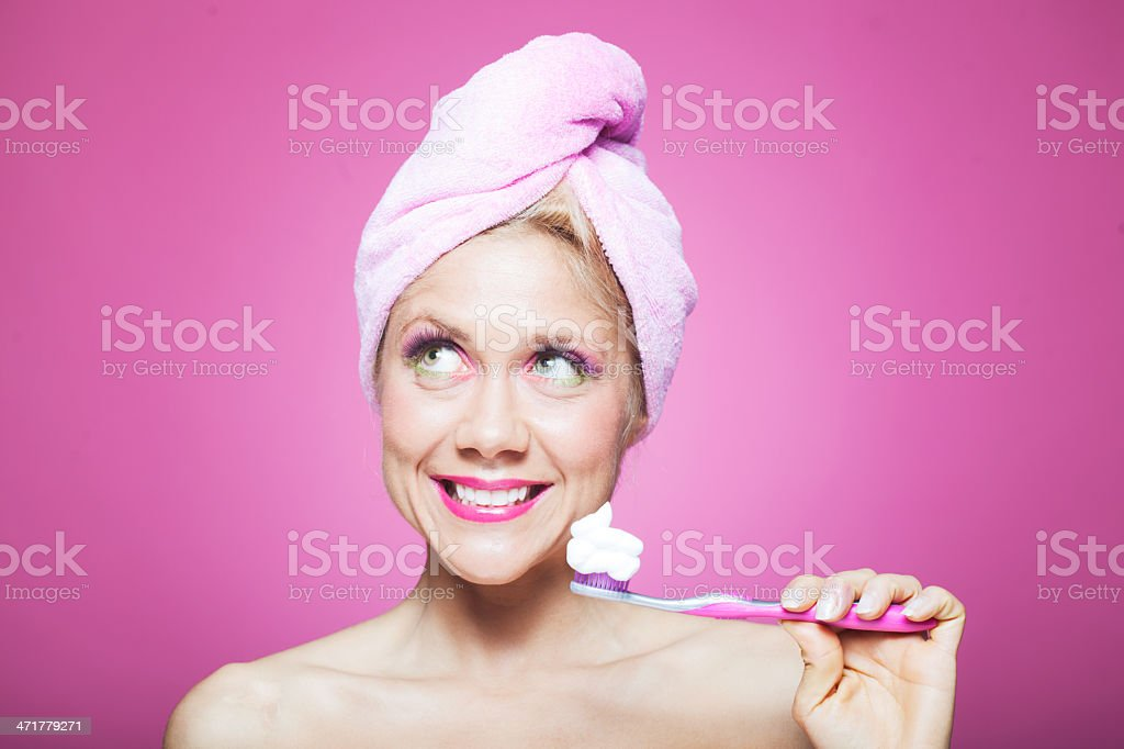 Early morning brushing teeth after shower. royalty-free stock photo