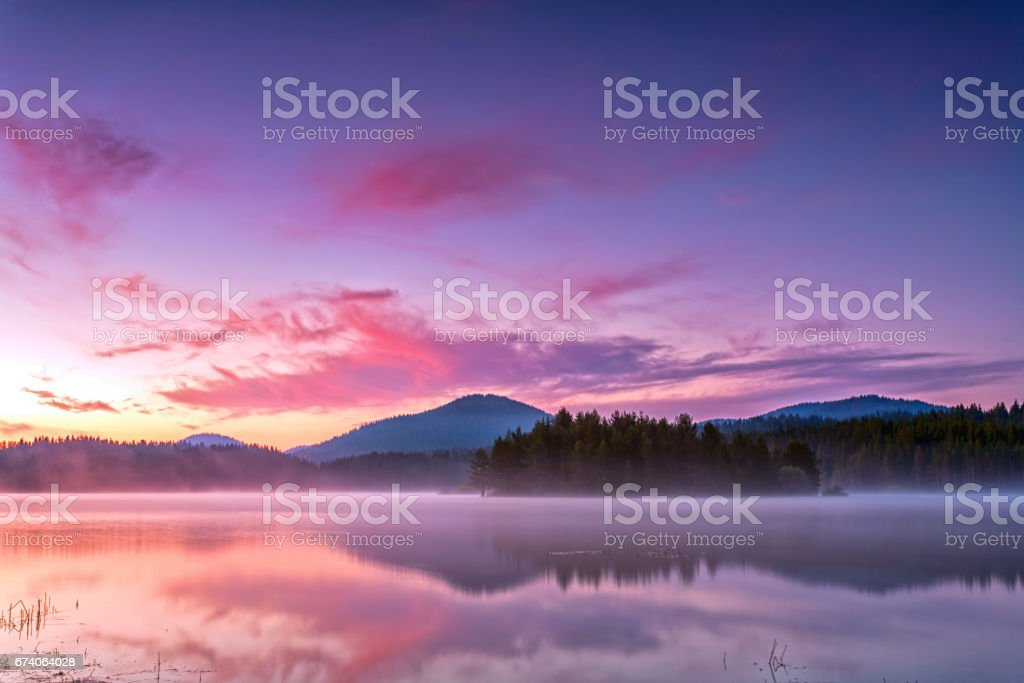 Early morning by the purple lake stock photo