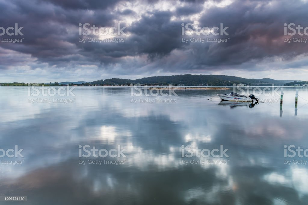 Early Morning Clouds and Reflections on the Bay stock photo