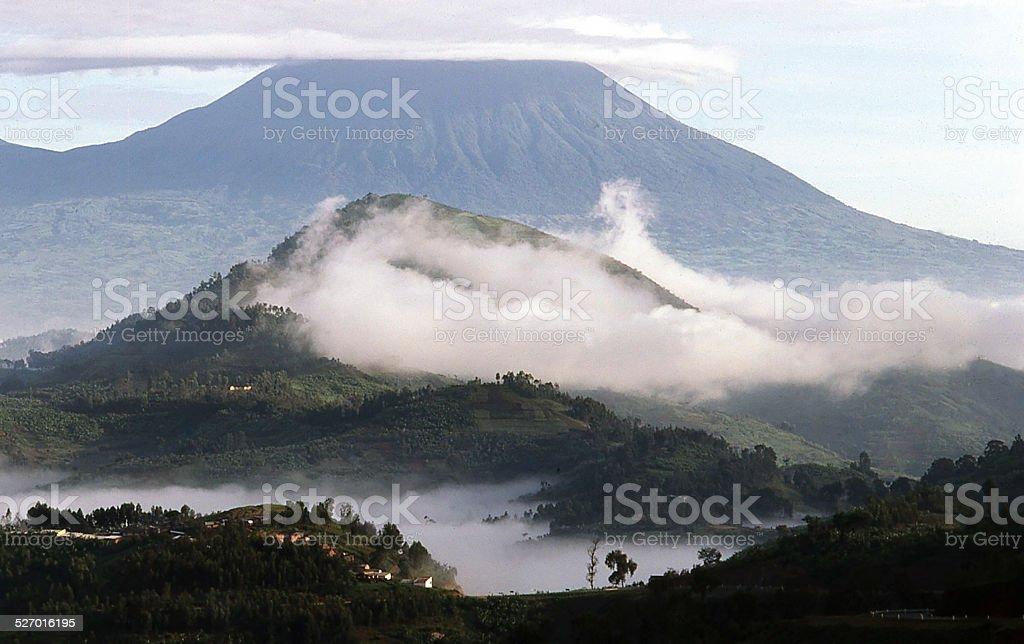 Early Morning Clouds Lifting over Virunga Volcanoes Rwanda stock photo