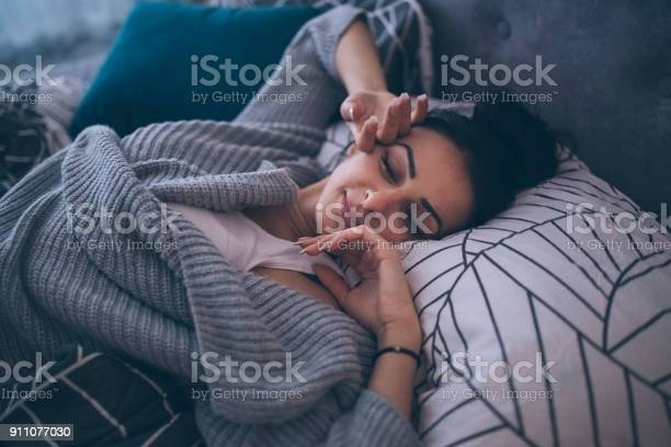 Early morning comfort Young woman waking up at her own bed alone, with a smile 20-29 Years Stock Photo