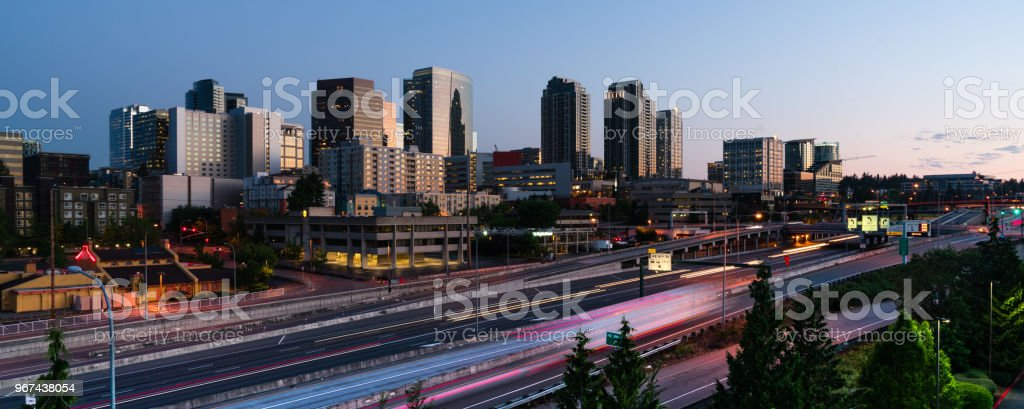 Early Morning Commuters Create Light Trails Before Rush Hour in Bellevue Washington stock photo