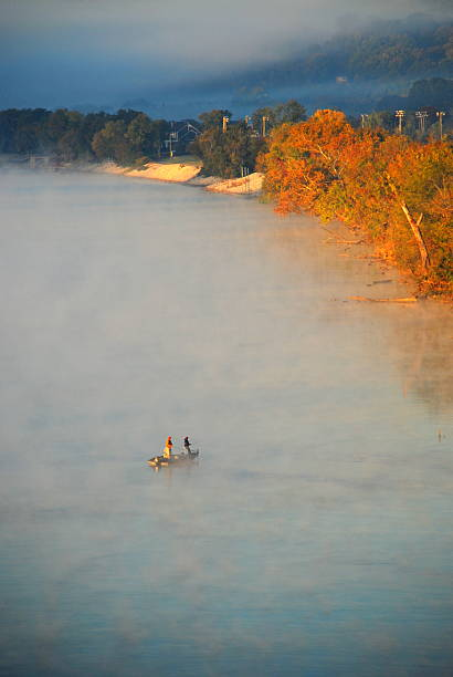 Early Morning Fishing on the Tennesse River Two men fishing a bend of the Tennessee river on a misty early October morning. Taken from the DuPont bridge in Chattanooga. tennessee river stock pictures, royalty-free photos & images