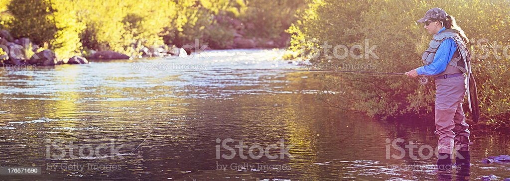 Early Morning Fly Fishing on Montana River stock photo