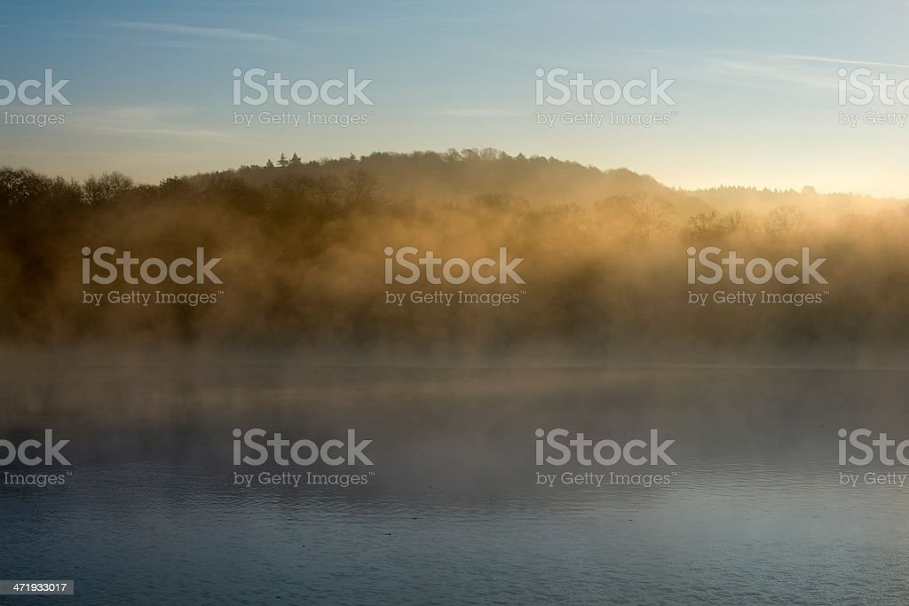 Early morning fog at a lake stock photo
