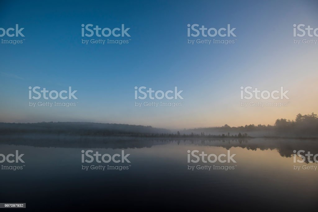 Early Morning fog on a Quiet Lake stock photo
