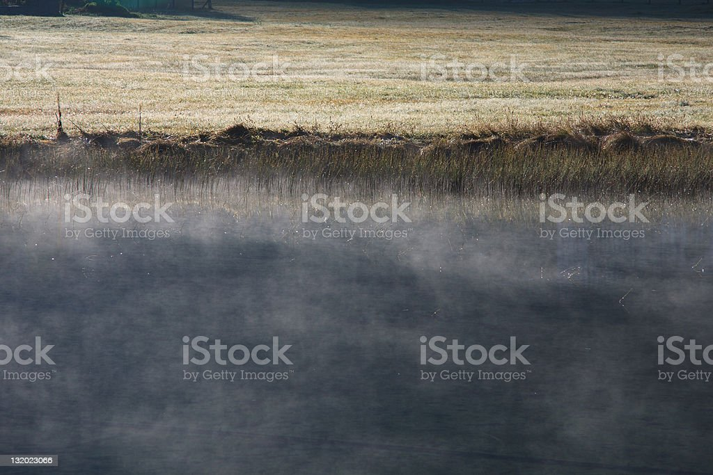 early morning fog on the lake royalty-free stock photo