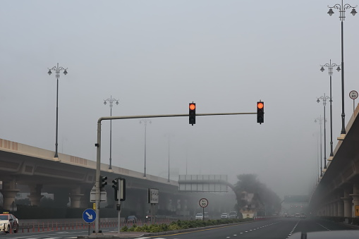 Early morning fog on the road, Dubai, United Arab Emirates