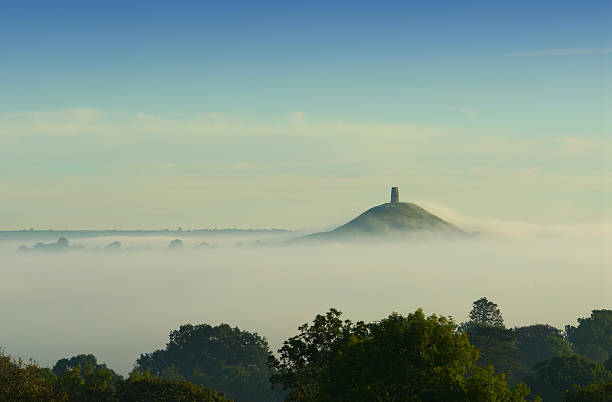 Early morning fog rolling in over Glastonbury Tor http://www.charliebishop.com/img/s9/v89/p1812113955.jpg somerset england stock pictures, royalty-free photos & images