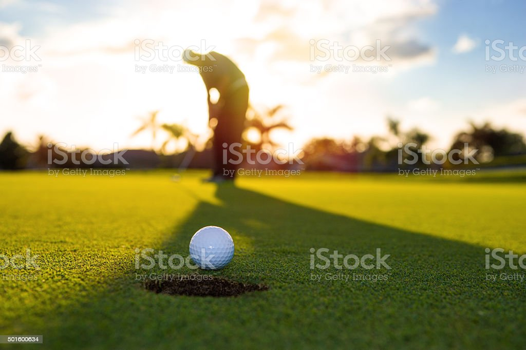 Early morning golf putting stock photo