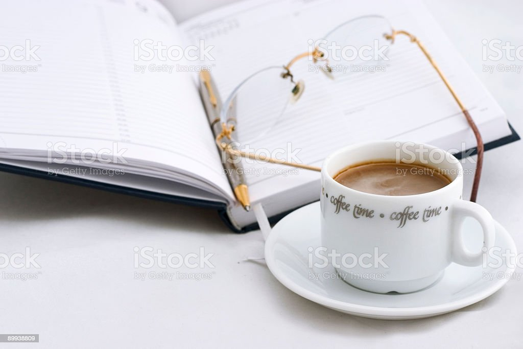 early morning in the office  (2, with glasses) royalty-free stock photo