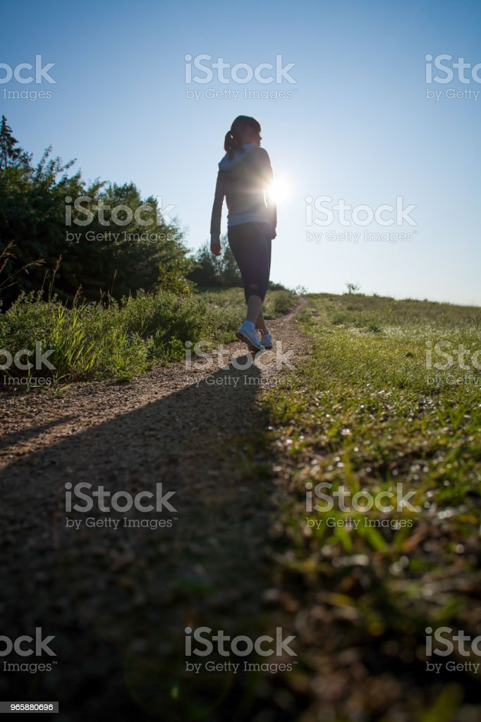 Early morning jogging on footpath - Royalty-free 16-17 Years Stock Photo