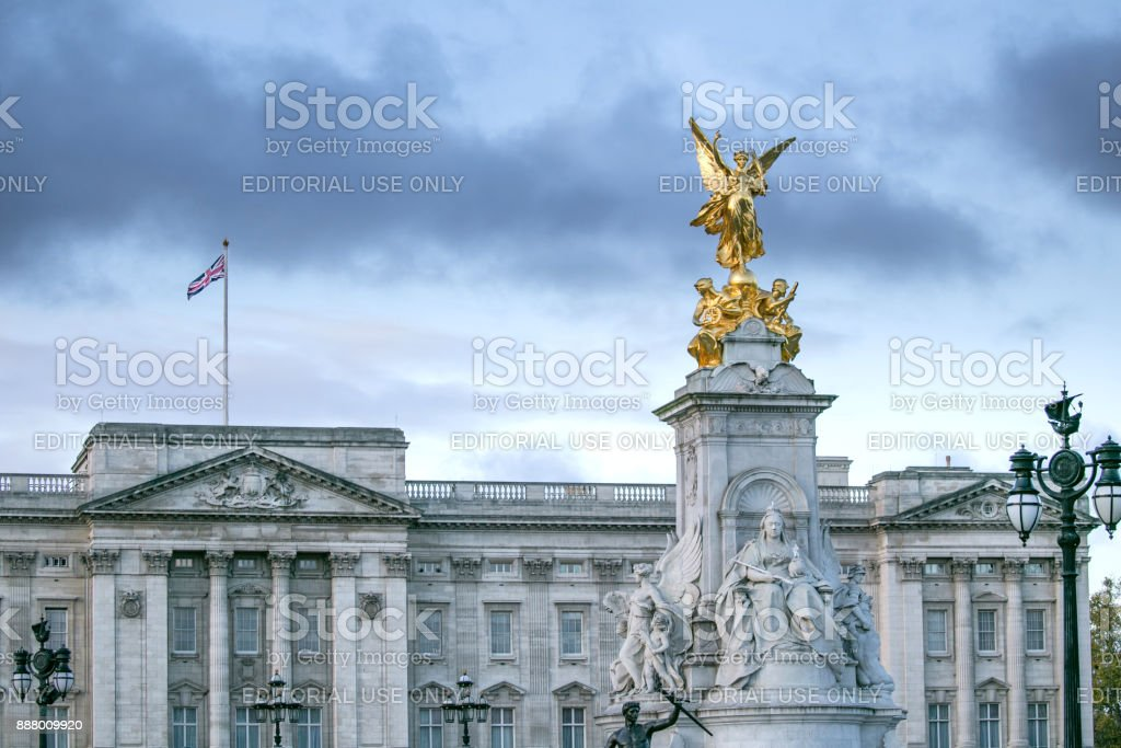 Early morning light illuminates the Queen Victoria memorial stature outside Buckingham Palace, Westminster, London. stock photo