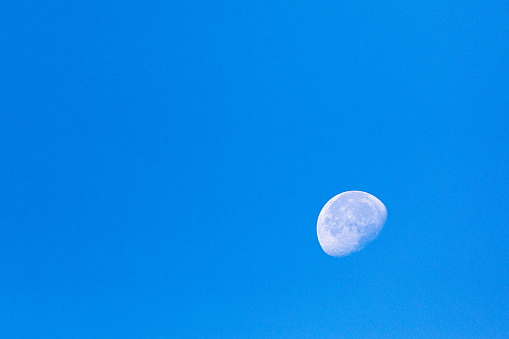 Early morning light, with the moon still present against a clear blue sky.