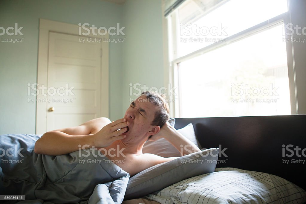 Early Morning Man Wakes Up with a Yawn royalty-free stock photo