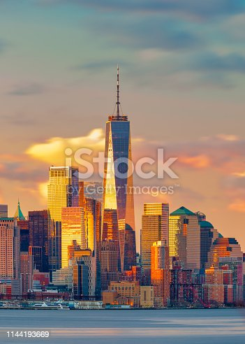 break of dawn the color of the sky and the lights of the Manhattan skyline