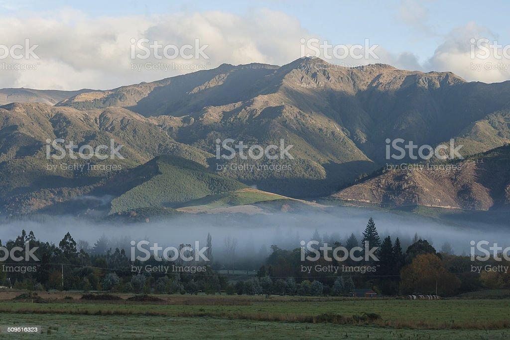 early morning mist above Hanmer Springs stock photo