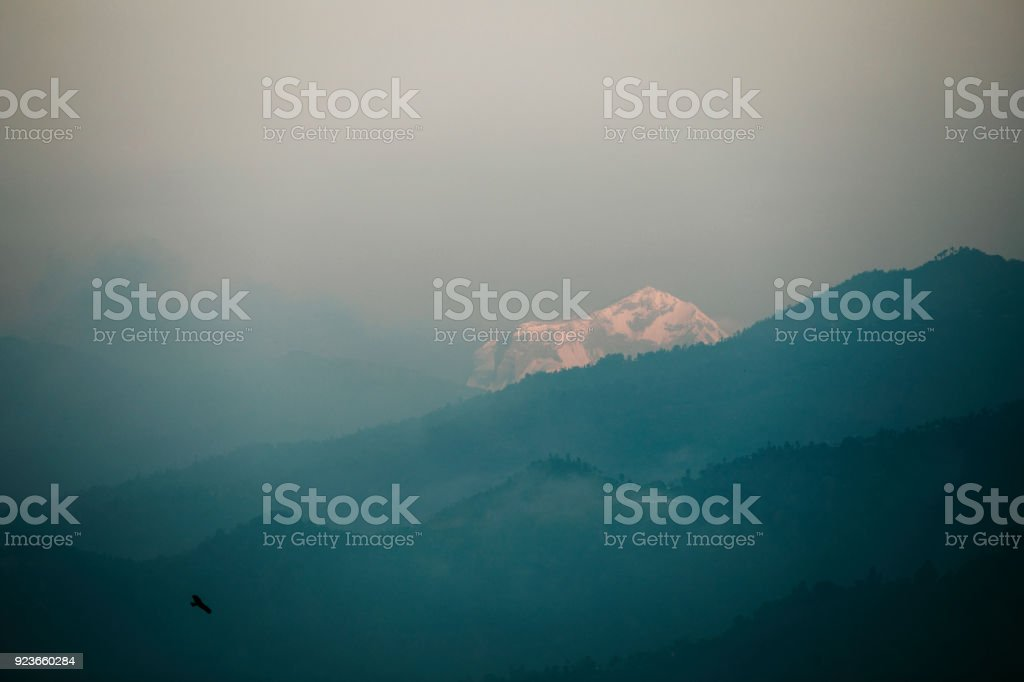 Early morning mist at Himalaya mountain view from Pokhara stock photo