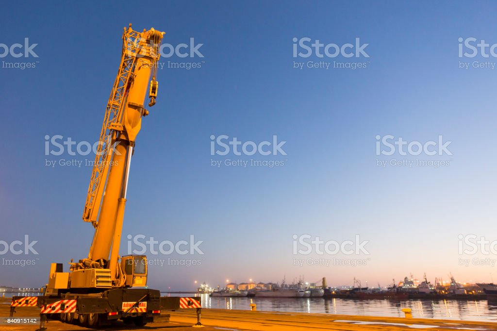 Early morning mobile crane preparing for the day stock photo