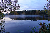 istock Early morning on the lake. Fog over the lake. Forest lake in calm weather. 1292135548