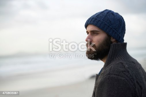 Shot of a outdoorsy young man at the ocean