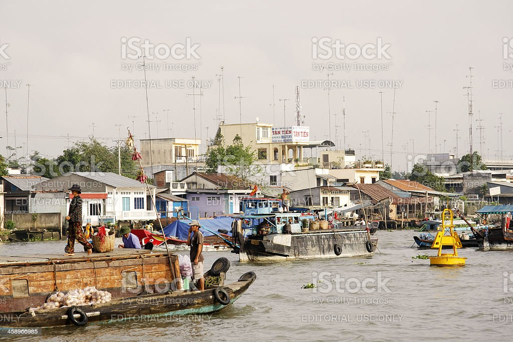 Early morning river traffic in Cai Be stock photo