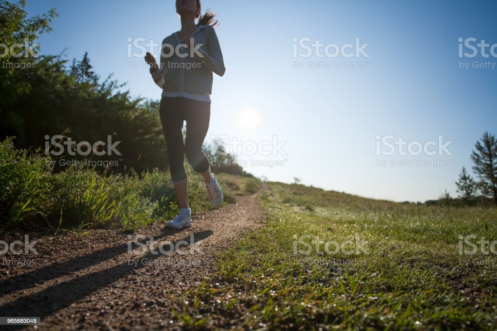 Early morning run on footpath - Royalty-free 16-17 Years Stock Photo