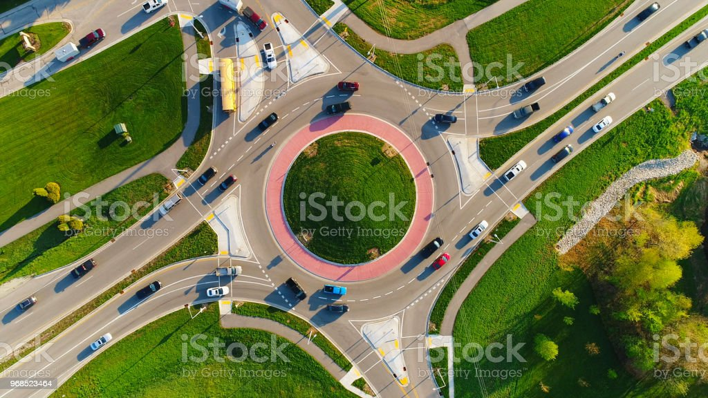 Early morning rush hour at busy city roundabout stock photo
