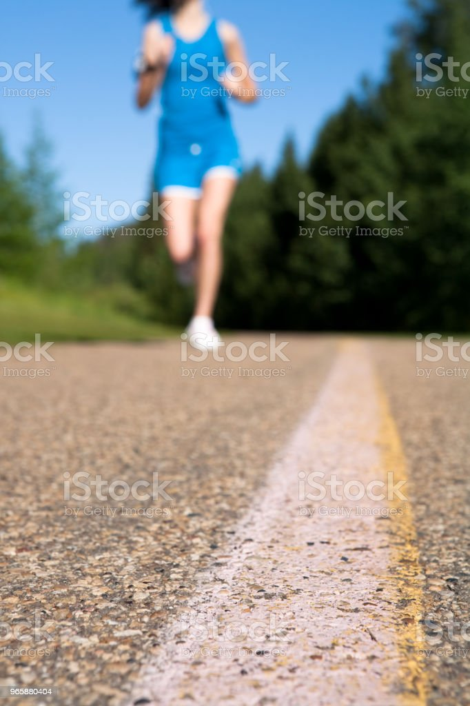 Early morning summer jog - Royalty-free 16-17 Years Stock Photo