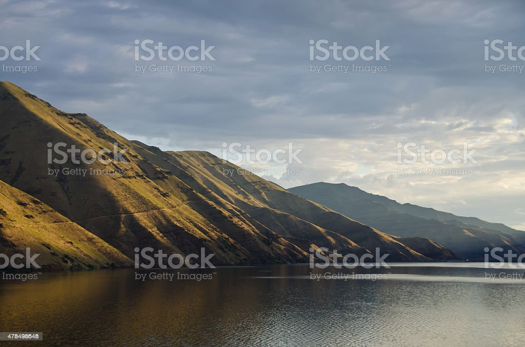 Early Morning Sun Rising Across Hells Canyon stock photo