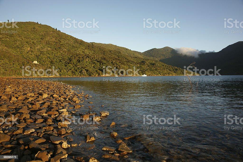 Early morning sun striking stoney beach royalty-free stock photo
