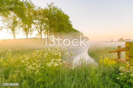 istock Early morning sunrise during a beautiful springtime day over the Zwartendijk near Kampen 1225763425