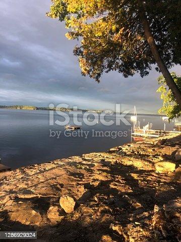 istock Early morning sunrise over lake 1286929324