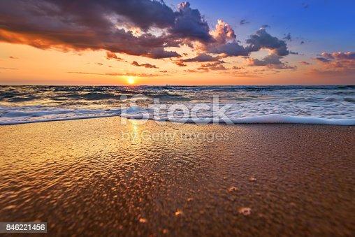 istock Early morning, sunrise over sea. Golden sands. 846221456