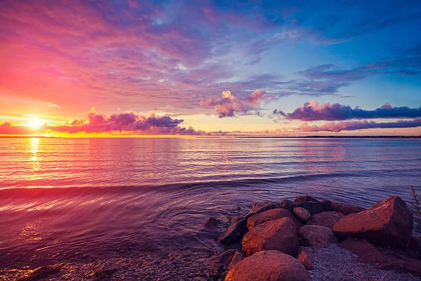 early morning , sunrise over sea - pink sunrise bildbanksfoton och bilder