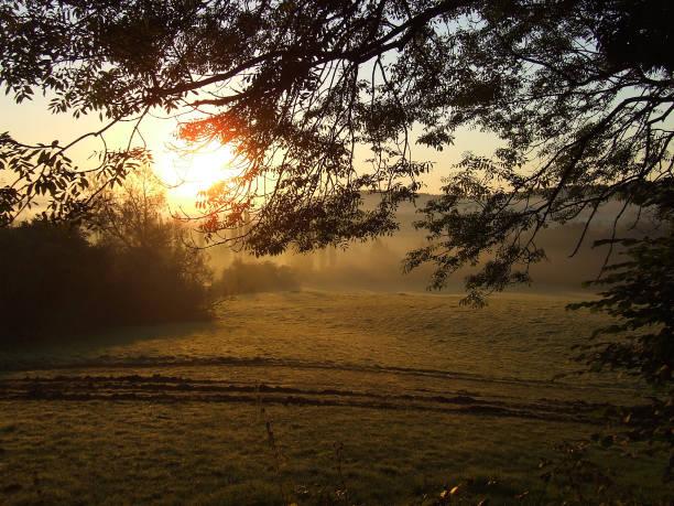 Early morning sunrise over the farm fields, Pontypool, Wales stock photo