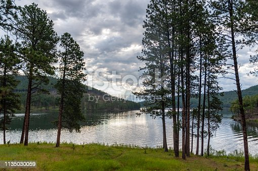 Sheridan Lake, in South Dakota's Black Hills, early in the Morning, after a thunder storm had passed over the area.