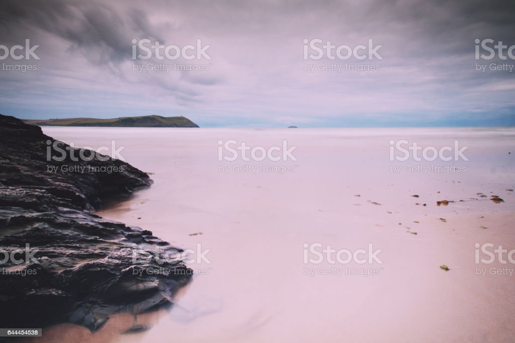 Early morning view of the beach at Polzeath Vintage Retro Filter. stock photo