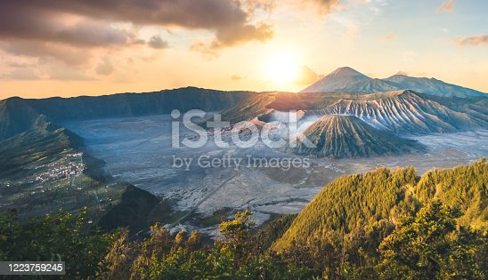 istock Early morning view of the Bromo caldeira in East Java in Indonesia. The volcanic formation of a few volcanoes, with the famous volcano Bromo and the Semeru volcano in the background 1223759245