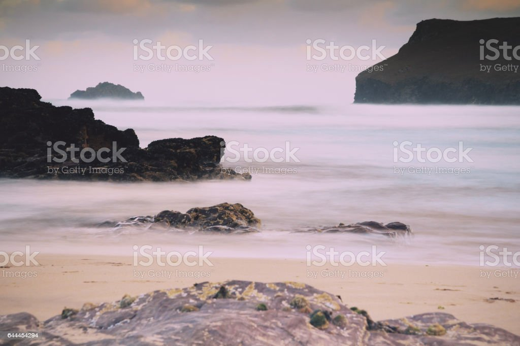 Early morning view over the beach at Polzeath Vintage Retro Filter. stock photo