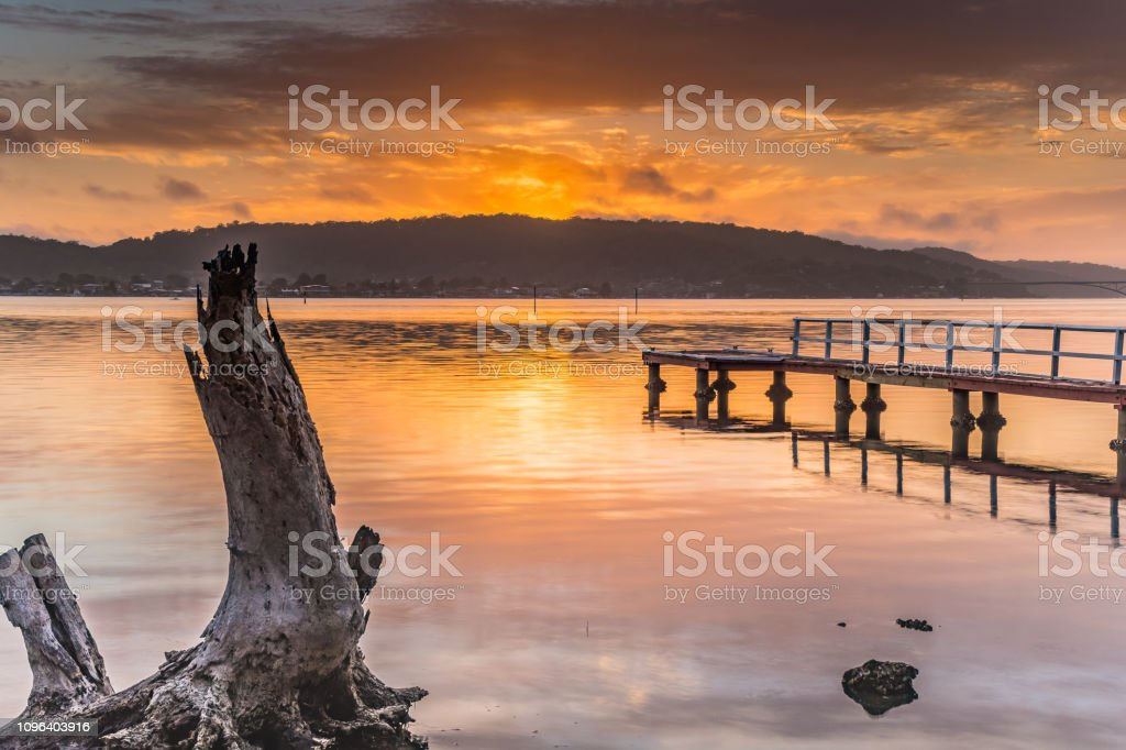 Early Morning Waterscape with Wharf stock photo