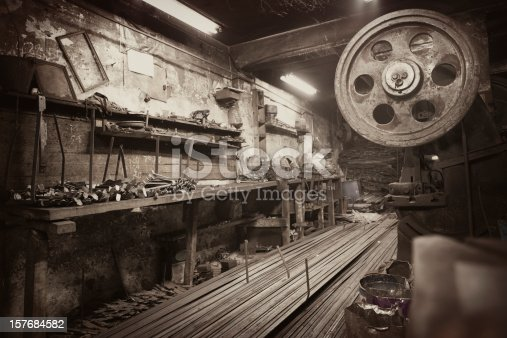 Early 90th century metal workshop with a press
